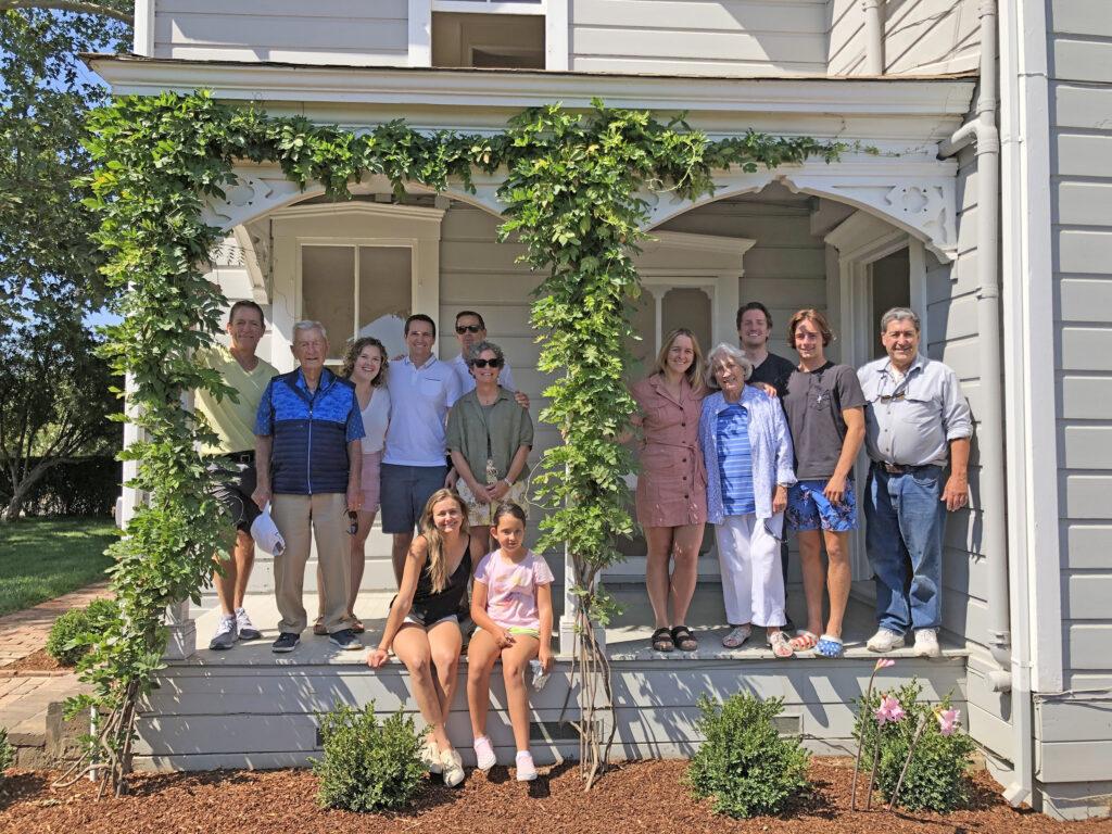 family gathered on farmhouse porch